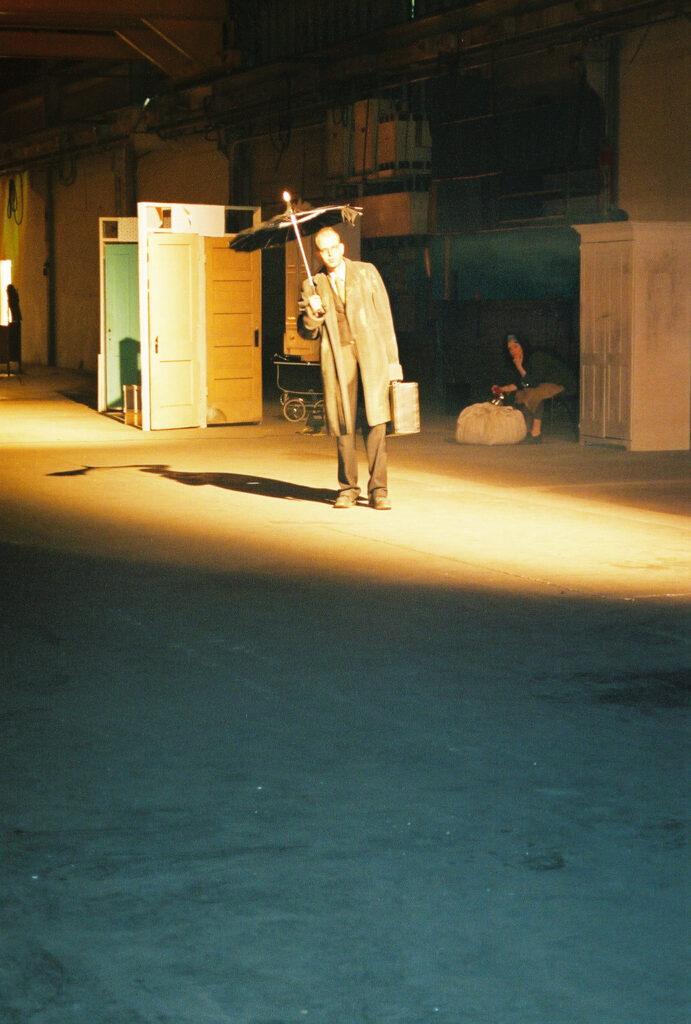 man under the umbrella- by Gülgün Kayim 2003