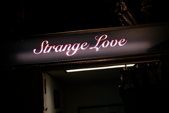 strangeLove featured - bright sign with strange love written