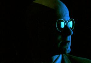 Strange Love 1 - man's face in a dark blue light