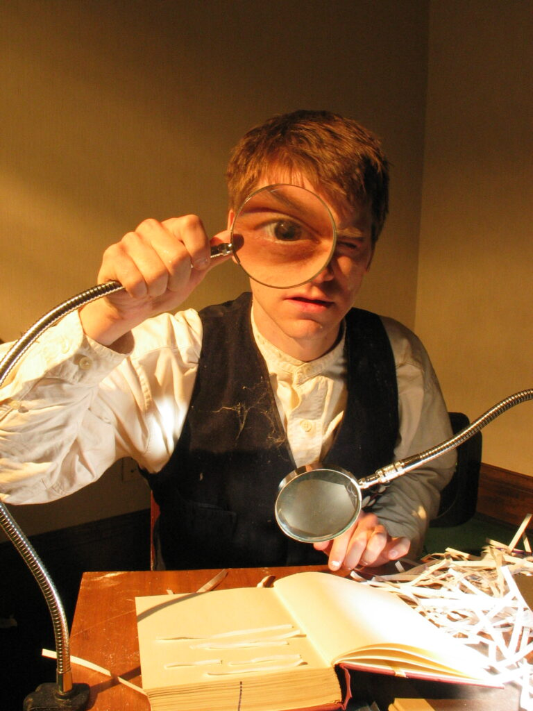 The hidden room - 2007 - boy with magnifying glass that magnifies one of his eye-